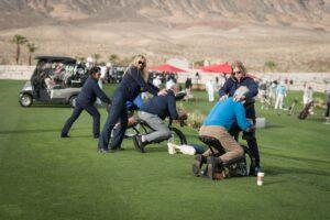 Golfers receive chair massage in a golf tournament